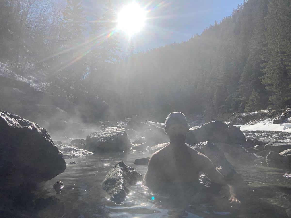 Man in Lussier Hot Springs in the morning