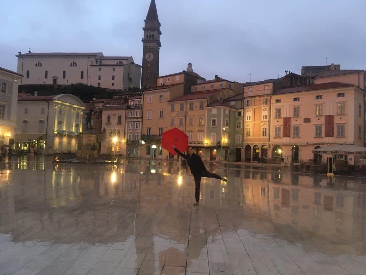 Woman with umbrella in Tartini Plaza, Piran, Slovenia