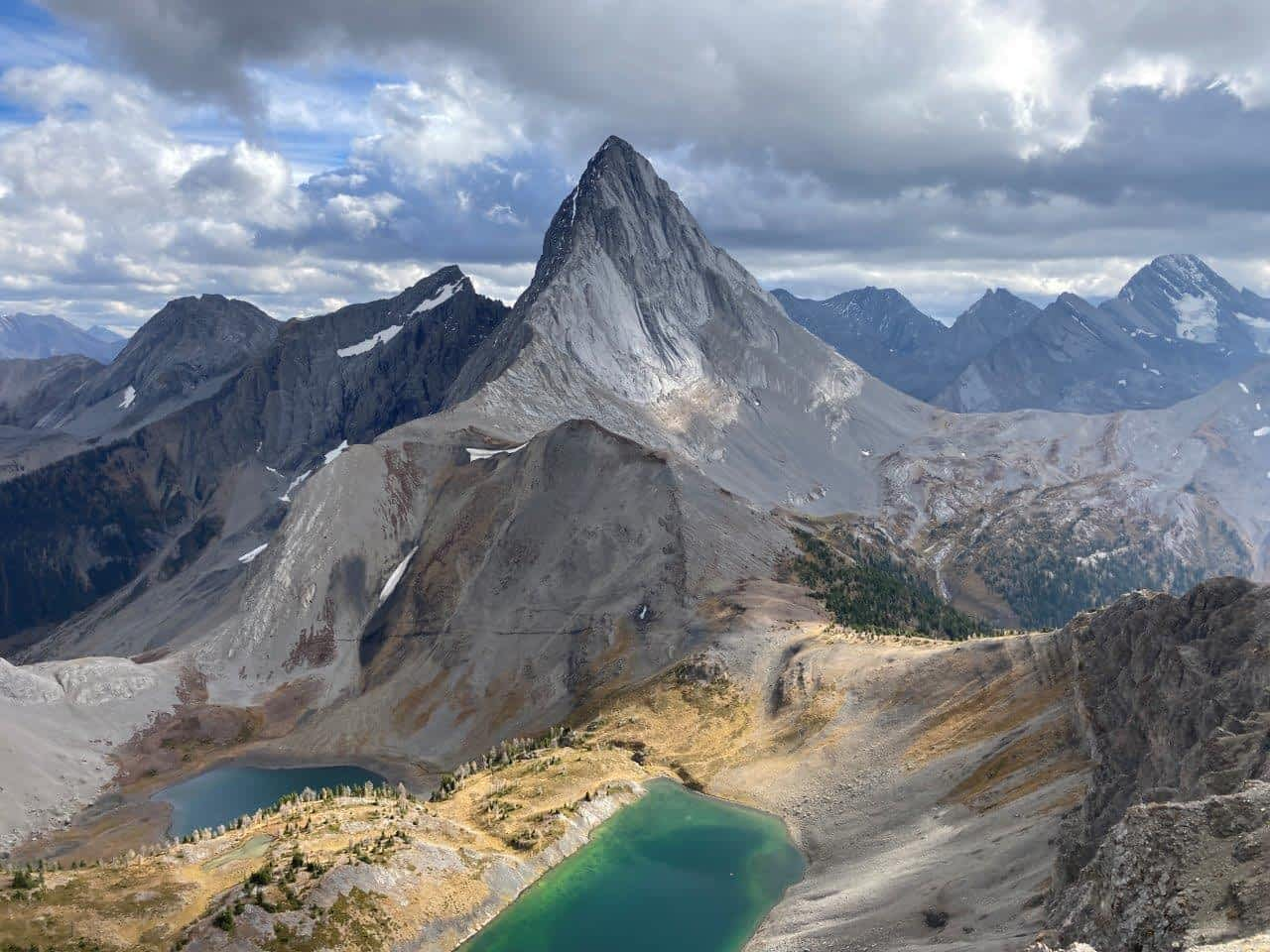 Two green lakes and a sharply peaked mountain on the Smutwood Peak hike, one of the best hikes Canmore