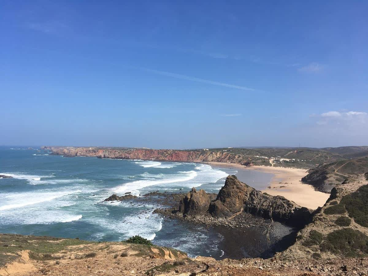 View over cliffs and ocean to beach on Costa Vicentina Portugal