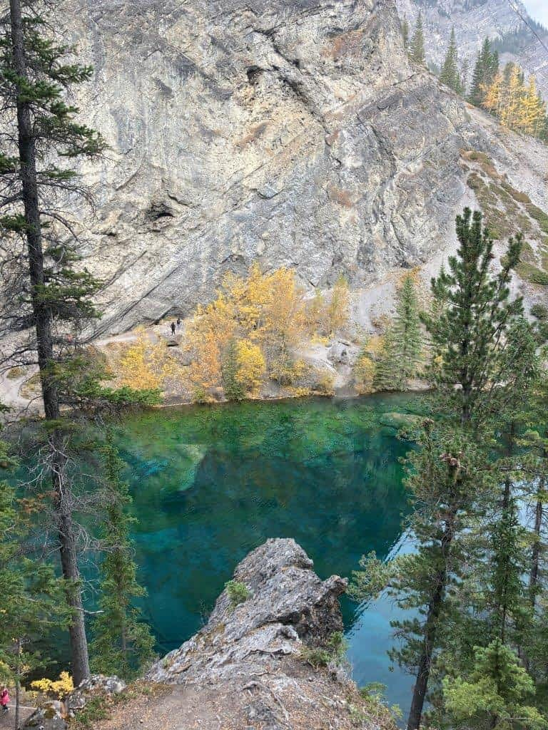 Green lake with clear water on one of the best easy hikes Canmore offers
